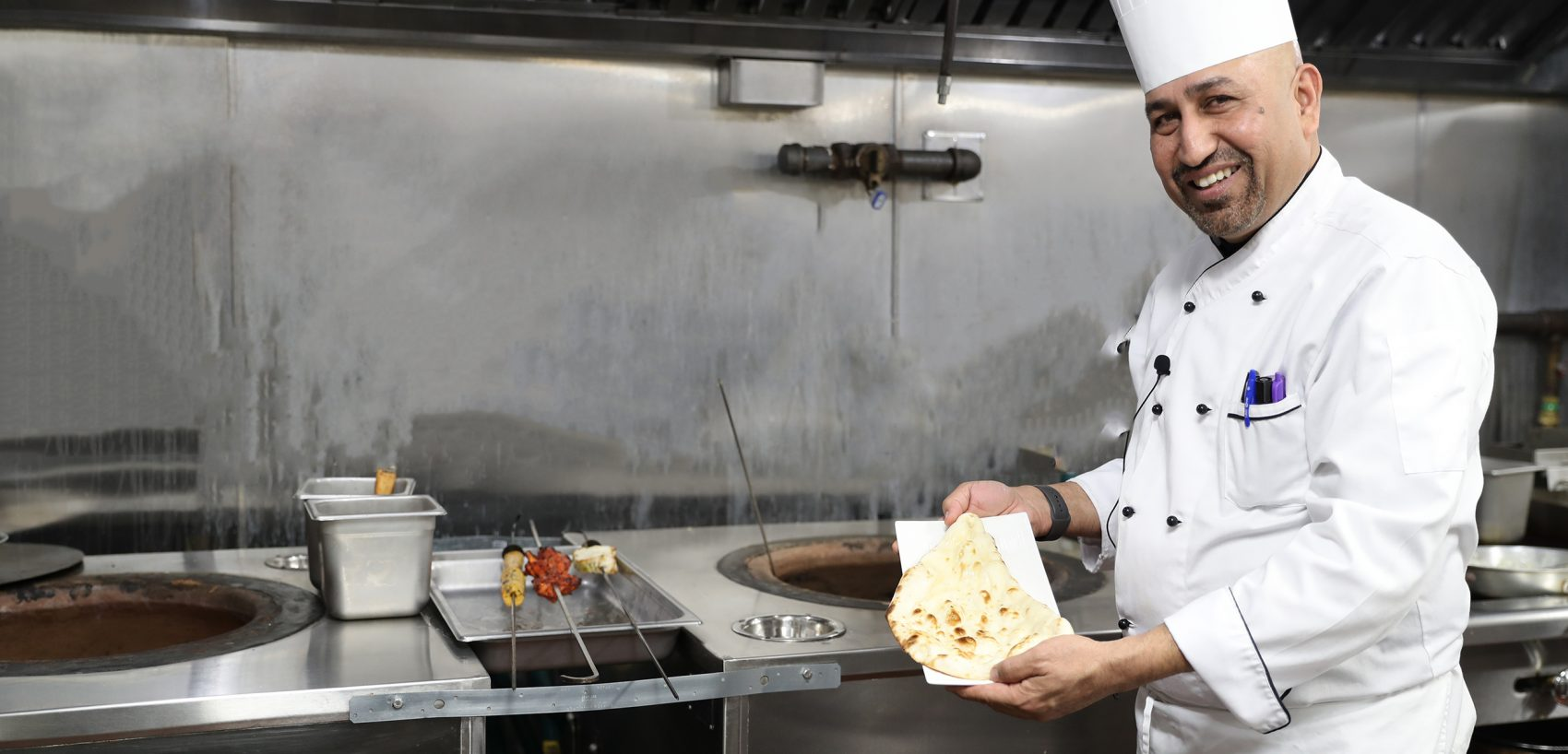 Michelin Starred Chef Raamanuj Sharma of Zaika New York making naan using GULATI Restaurant Tandoor
