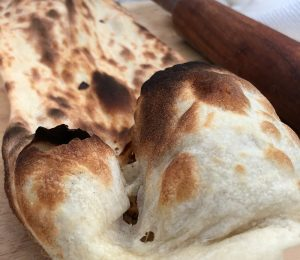 Fresh baked Naan cooked in a GULATI Home Tandoor
